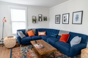 blue couch with area rug