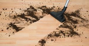 vacuuming dirt on hardwood floor